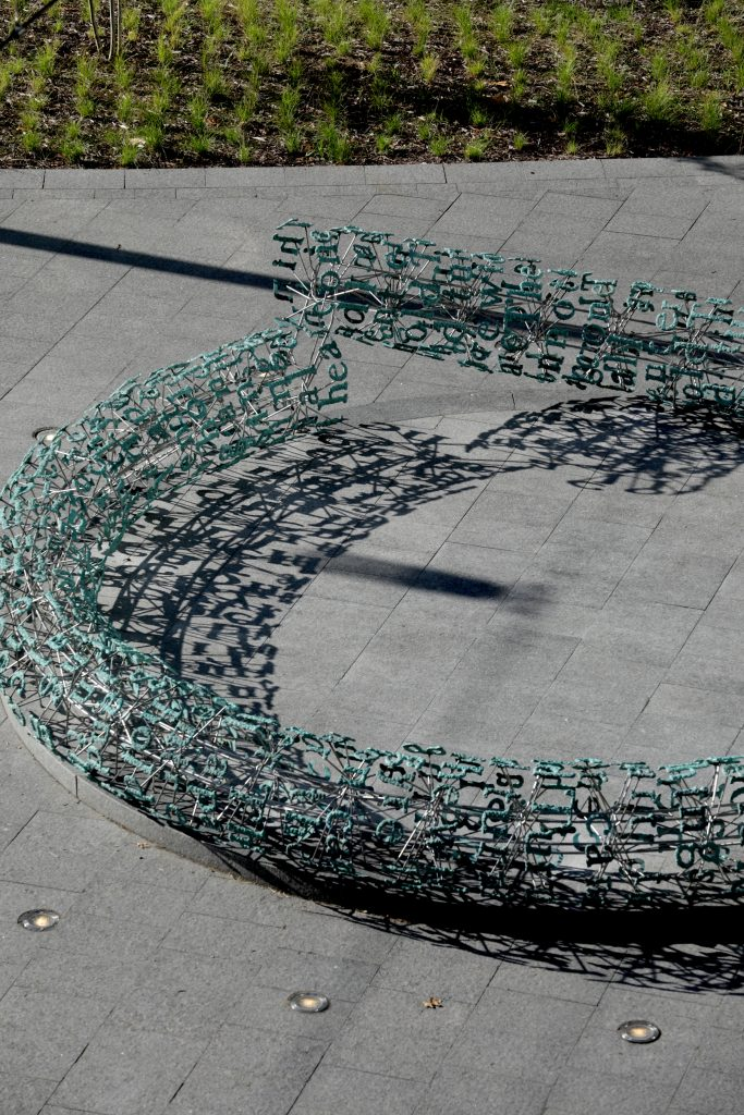 Partial aerial view of Broken English from the North side of the HSSC building showcasing the disconnect of the sculpture which is partially why it is named Broken English